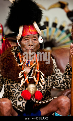 Elderly Naga tribesman in traditional outfit during the annual Hornbill Festival at Kisama, Kohima, Nagaland, India - Stock Photo