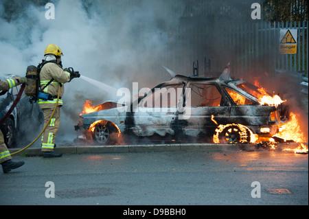 Stolen Car on Fire Arson Riot Rioting - Stock Photo