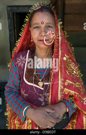 A Gaddi tribal matriarch poses for the camera at the Himalayan village of Kugti in Himachal Pradesh, India - Stock Photo