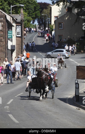 Gypsies drive their horses into town to wash them before parading them for sale at Appleby Horse Fair, in Cumbria, - Stock Photo