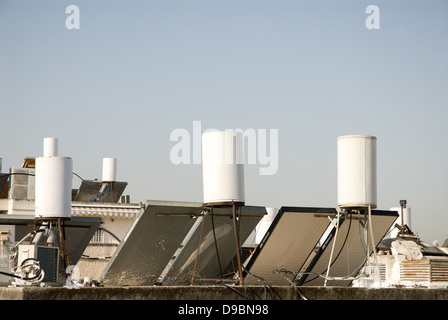 Solar panels for hot water provision in apartment building of Israel - Stock Photo