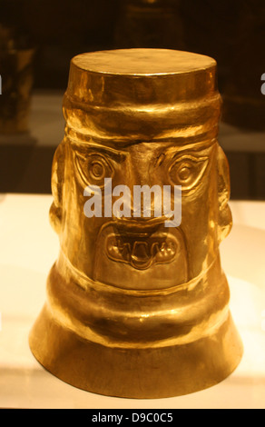 Inverse-Face Beaker.  Peru Sican (Lambayeque) 9th-11th century. Hammered gold. The large gold Sican beakers are - Stock Photo