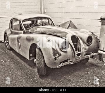 Jaguar XK140 classic car restoration garage British repair mechanic quality beautiful restore Fixed Head Coupé - Stock Photo