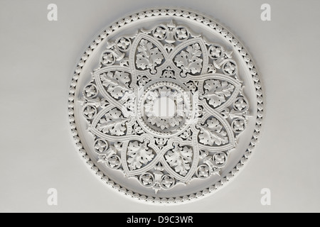 Old antique plaster ceiling plate or rose in an old victorian house - Stock Photo