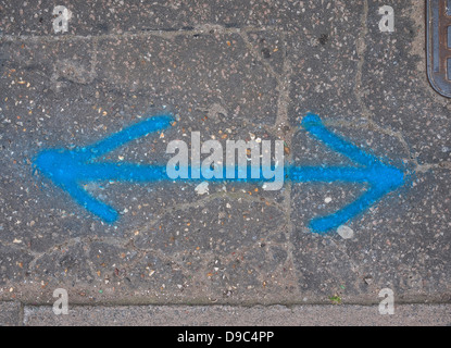 double arrows painted on pavement - Stock Photo
