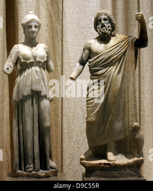 left Marble statuette of Athena.  Perhaps from Asia Minor, late 2nd c. BC  The goddess is represented in sleeved - Stock Photo