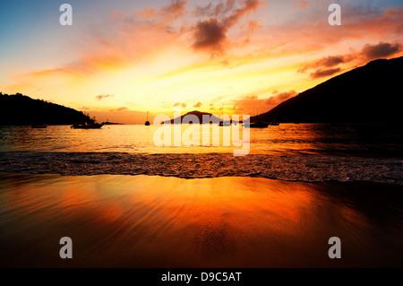 Sunset over Port Launay Marine National Park, Mahe, Seychelles - Stock Photo