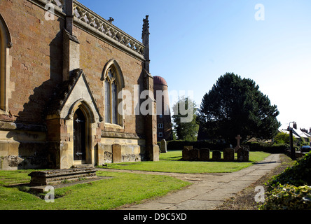 All Saints' Church and windmill, Braunston village, Northamptonshire, Northants, England, UK,GB,rural England, country - Stock Photo