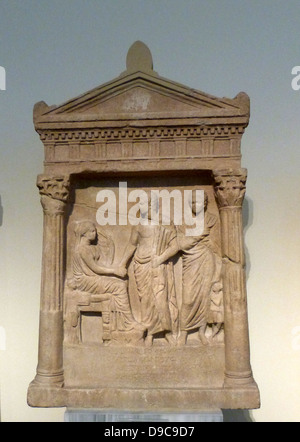 Grave stele made of marble, found on Rheneia. The monument has two Corinthian half-columns supporting an epistyle - Stock Photo