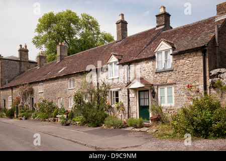 Row of stone terraced houses  in the village of Mells, Someret, UK - Stock Photo