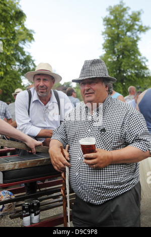 Gypsy men gather to socialise and trade horses at Appleby Horse Fair, in Cumbria, England - Stock Photo
