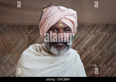 Portrait of a holy man at the Kumbh Mela 2013 in Allahabad, India - Stock Photo