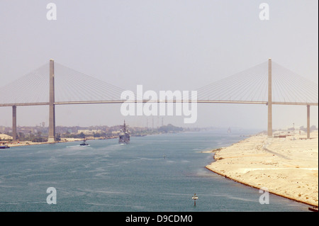 US Navy aircraft carrier USS Dwight D. Eisenhower approaches the Friendship Bridge while transiting the Suez Canal - Stock Photo