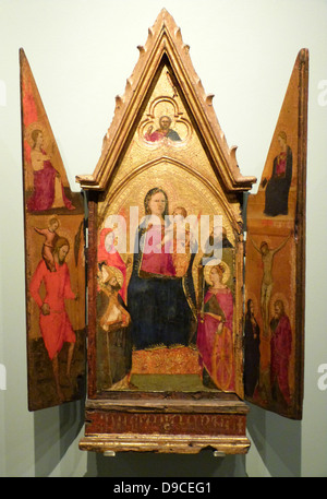 The central leaf depicts the Virgin and Child enthroned with four saints. The side leaves depict the Annunciation, - Stock Photo