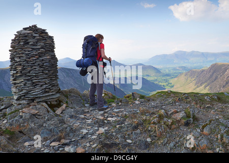 A hiker with a large backpack on the summit of Dale Head, Buttermere Fells in the Lake District. - Stock Photo