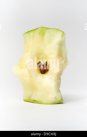 A green apple core showing the seeds - Stock Photo