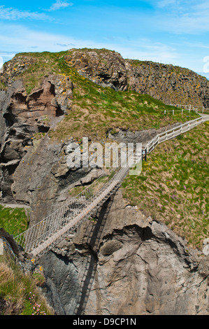 stunning Carrick-a-Rede Rope Bridge in Northern Ireland, UK - Stock Photo