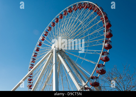 Detail of the ferris wheel at the Navy Pier in Chicago with beautiful clear blue sky in the background. - Stock Photo