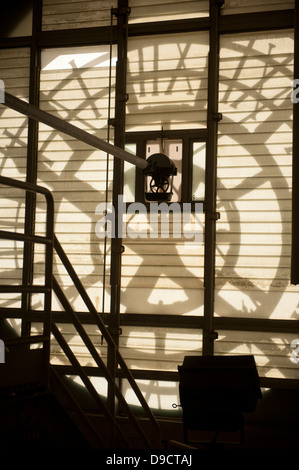 The Old Post Office Pavilion Clock Tower a view from inside behind the clock face. The sun casting shadows of the - Stock Photo