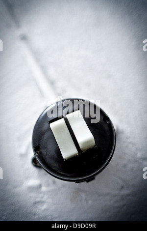 Old light switch in a cellar rising, Old light switch in a basement stairway - Stock Photo