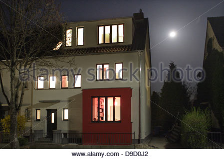 House lit up at night, Bonn, Germany - Stock Photo