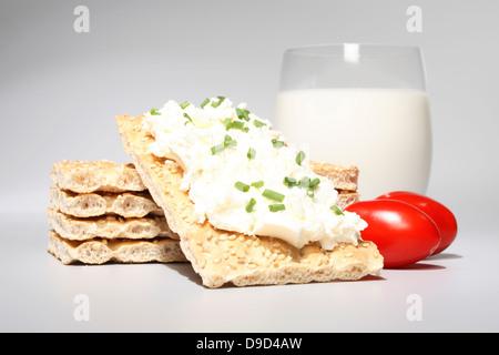 Crispbread with cream cheese and milk - Stock Photo