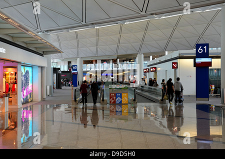 Concourse at Hong Kong Chek Lap Kok Airport - Stock Photo