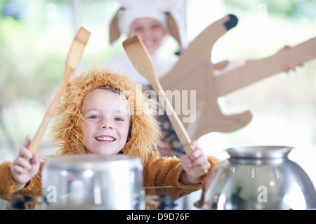 Children pretending to play music instruments - Stock Photo