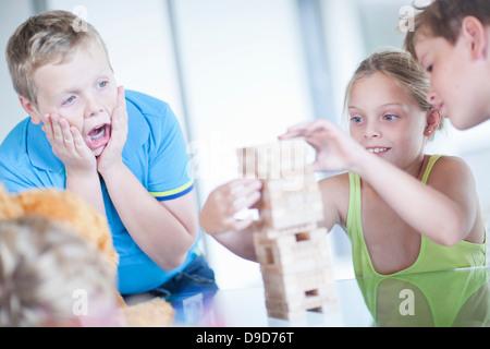 Children playing wood blocks - Stock Photo