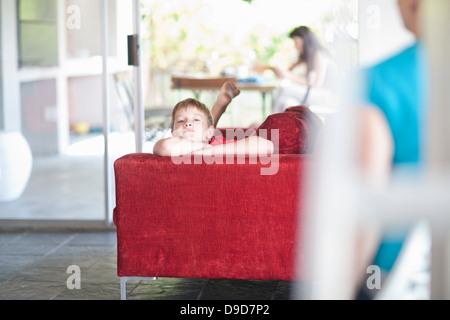Boy lying on sofa - Stock Photo