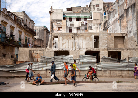 ruins and children playing in the old town La Habana Vieja , Havana, Cuba, Caribbean - Stock Photo