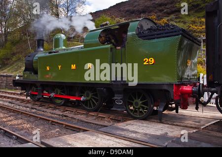 A steam train on the North York Moors railway. - Stock Photo
