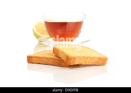 Rusk with lemon tea - Stock Photo