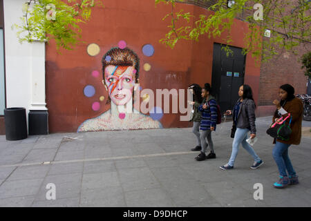 Brixton, London: 18th June 2013 - A mural of iconic musician and singer David Bowie has appeared on the wall of - Stock Photo