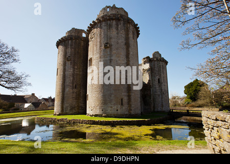 The ruins of Nunney Castle surrounded by its moat, built in the 1370s, near Frome, Somerset, England, UK - Stock Photo