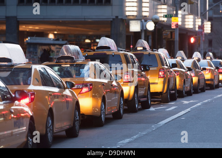 Yellow taxis in a row, New York City, USA - Stock Photo