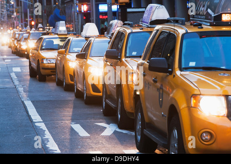 Queue of yellow taxis, New York City, USA - Stock Photo
