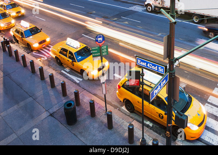 High angled view of yellow cabs in a row at pedestrian crossing New York City, USA - Stock Photo