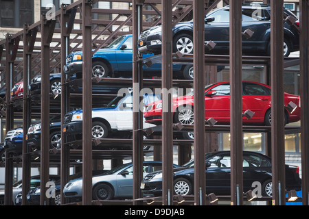 Cars parked in automatic parking lot - Stock Photo
