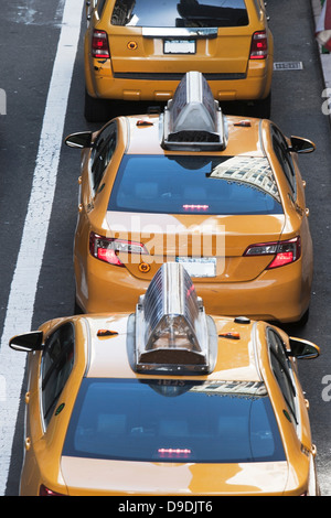 Yellow taxis in a row 42nd Street New York, USA - Stock Photo