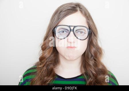 Girl wearing fake glasses - Stock Photo