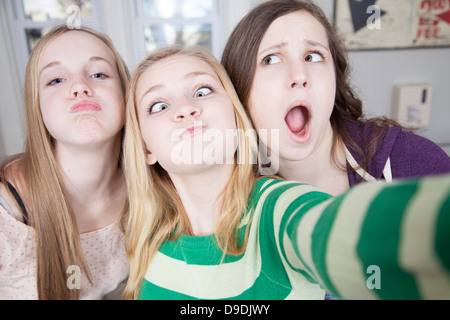 Teenagers pulling funny faces - Stock Photo