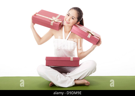 Business woman with gift box - Stock Photo