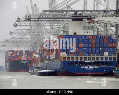Large container carrier ships along the quay of a container terminal in the port of Rotterdam, the Netherlands - Stock Photo