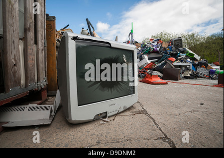 A pile of junked household electrical appliances awaiting recycling, UK - Stock Photo