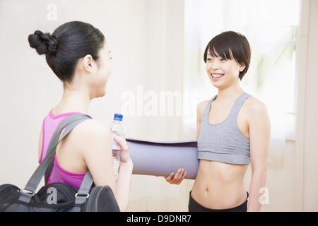 Women talking in gym - Stock Photo