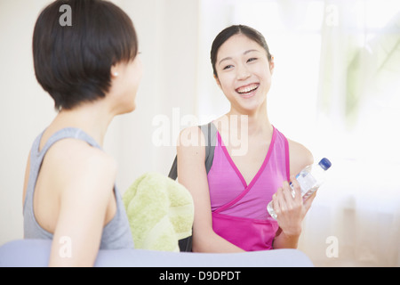 Women talking in gym - Stock Photo