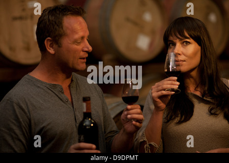 Sampling wine in barrels - Stock Photo