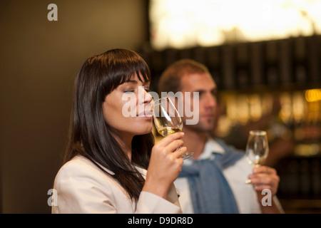 Wine tasting at wine growers shop - Stock Photo