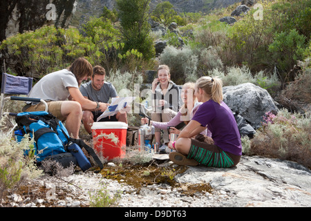Young group of hikers taking a break - Stock Photo
